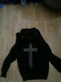 Black studded sweater with cross on back
