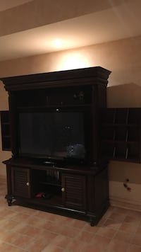 Black flat screen tv with brown wooden tv hutch Montréal, H1C 2C4