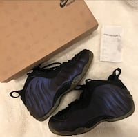 pair of black-and-purple Nike basketball shoes Jacksonville, 32202