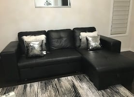 FREE DELIVERY - BLACK SECTIONAL COUCH + PULLOUT BED + STORAGE - 9/10