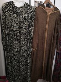 two black and brown long-sleeved dresses