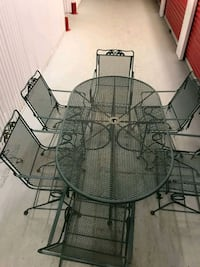 round black metal table with four chairs patio set