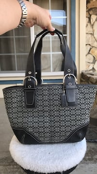 Black and gray monogrammed coach tote bag