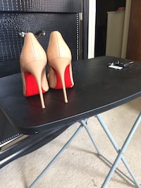 pair of beige patent leather stiletto shoes