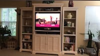 brown wooden TV hutch with flat screen television North Charleston, 29420