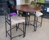 Bar stool height table and two chairs  Cartersville, 30121