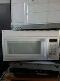 white General Electric microwave oven Toney, 35773