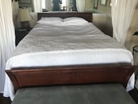 brown wooden bed frame with box springs San Francisco