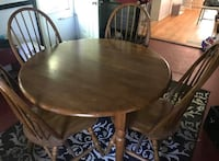 Round brown wooden table with four chairs dining set Indianapolis, 46241