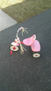 toddler's pink, white, and red trike