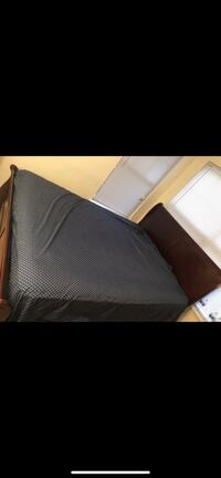 Brown wooden bed frame  Gainesville