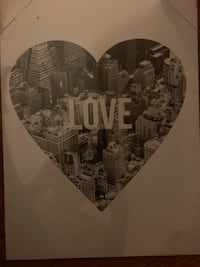 """""""Love"""" sign in heart on a black and white picture of the city Clark, 07066"""