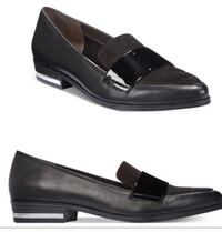 pair of black leather loafers New York, 10017