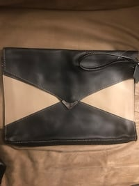 New with original packaging leather envelope clutch purse! Can also be used for a small computer as a laptop cover! Very sleek and elegant!  Saint Petersburg, 33713