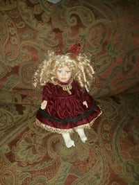 girl wearing red dress doll Magee