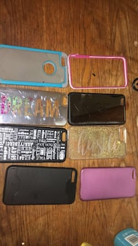 four black and one pink smartphone cases Racine, 53404