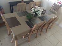 rectangular brown wooden table with six chairs dining set Palm Coast, 32137