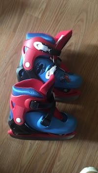 pair of red-and-blue inline skates Halifax, B3K 2M9
