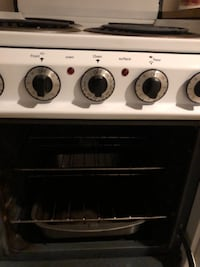 black and white 4-burner gas range oven East Northport