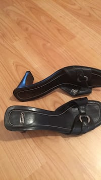 Pair of Coach black leather 8 m heeled shoes
