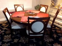 Cherry finish dining room table and 6 chairs