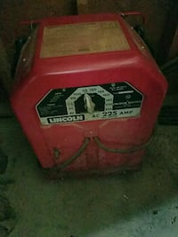 red and black Lincoln Electric welding machine Goodrich, 48438