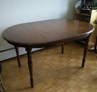 Oval cherry wood dining table