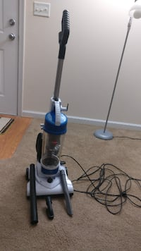 blue and gray upright vacuum cleaner STERLING