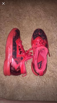 pair of red Nike running shoes Riverview, 33578