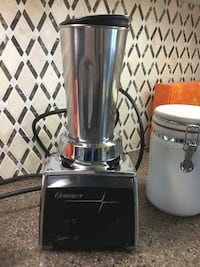Silver and black osterizer appliance
