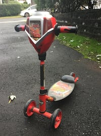 Toddler's red and black trike and safety gear - he 225 mi