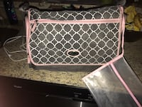 women's grey and pink sling bag