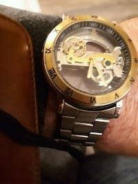round gold-colored chronograph watch with link bracelet Red Deer, T4N 5N5