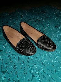 pair of studded black leather flat shoes Independence