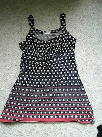 women's black and white polka-dot sleeveless top