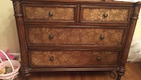 Brown wooden sideboard / dresser , 4 drawers, nice details throughout, minor chip on corner from move, otherwise great condition and drawers are very clean, barely used, great accent piece, furniture Union, 07083