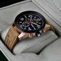 round black chronograph watch with brown leather strap Maryland