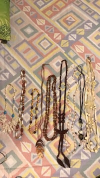 Three gold-colored necklaces