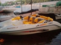 white and yellow personal watercraft South Kingstown, 02879