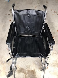 Wheel chair in great condition it is leather chair with foot padels