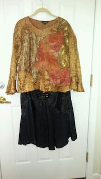 Black skirt and blouse.  Winnipeg, R2V 0Y9