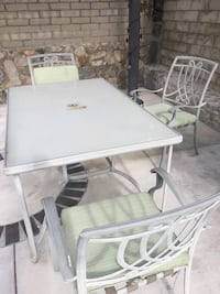 Outdoor patio table set. Glass top