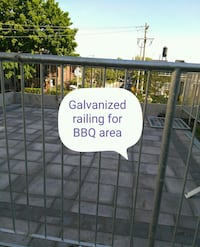 gray metal railing with text overlay Toronto, M6H 3T9