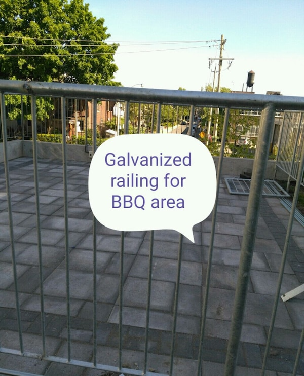 gray metal railing with text overlay a8d05bf4-64c7-45d5-9471-6feef6d15d8e