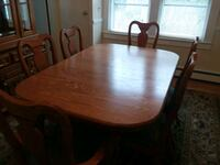 oval brown wooden dining table with chairs Closter, 07624