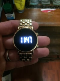 round gold digital watch with gold links