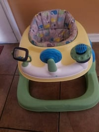 baby's yellow and green walker and activity center