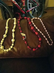 three red, green and brown beaded necklaces