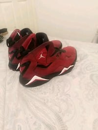 pair of red-and-black Nike basketball shoes Albuquerque, 87121