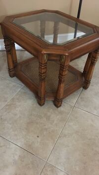 Solid wood and heavy end table with beveled glass and in perfect condition. Lake Placid, 33852
